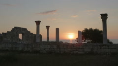 Ancient Greek basilica and marble columns in Chersonesus Taurica on the sunset Stock Footage