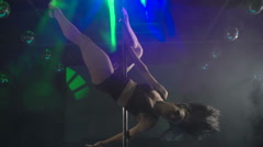 Fitness pole dance performance strong girl performing acrobatic tricks Stock Footage