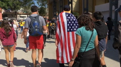People leaving Olympic stadium hyperlapse with ending on American Flag Stock Footage