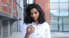 Girl Walking and Using Smartphone for Online Browsing Stock Footage