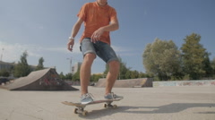 Unrecognizable young man skateboarding. Close-up. SLOW MOTION Stock Footage