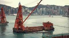 Barge dredging a harbor in Hong Kong. Stock Footage