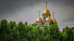 Orthodox cathedral with golden domes and timelapse with running dramatic clouds Stock Footage