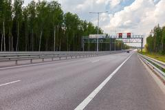 Toll road. Russian highway number M11 Stock Photos