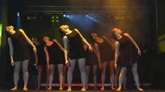 A group of girls dancing on the stage in the fog Stock Footage