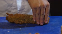 Slicing fried sushi roll Stock Footage