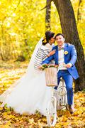 Bride and groom in autumn park Love Life Stock Photos