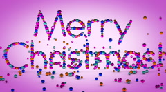 Merry Christmas text made from color xmas balls in particles Stock Footage