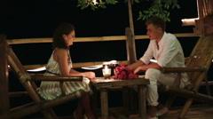 Romantic couple having dinner, clinking glasses Stock Footage