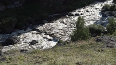 Horizontal panning on rough mountain river.  Stock Footage