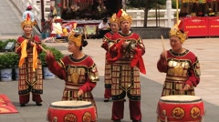 People play traditional drum instruments in the Datang Furong Garden. Stock Footage