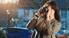 Young female photographer Stock Footage