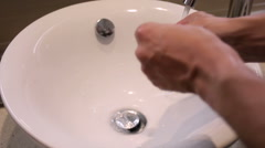 Guy washes hands in sink Stock Footage
