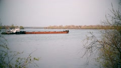 Long cargo barge on a river Stock Footage