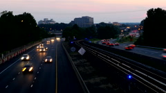 Beltway traffic train time-lapse dusk Stock Footage