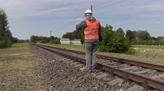 Railroad worker walking near railway Stock Footage