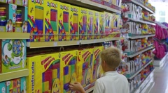 NOVOSIBIRSK, RUSSIA -: a child in a toy store looking at a product Stock Footage