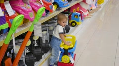NOVOSIBIRSK, RUSSIA a child in a toy store looking at a product Stock Footage