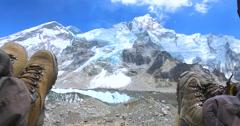 Tourist background Feet on the Khumbu Glacier. Stock Footage