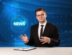 Modern televison presenter telling the news with tehnology background Stock Photos