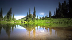 Stream and lake, Mount Rainier National Park, Washington Stock Footage