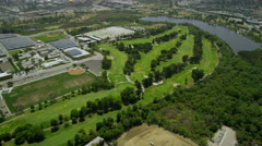 Helicopter aerial view flying over Californian golf course Stock Footage