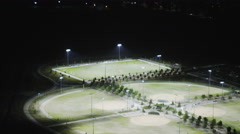 Aerial view of soccer football match at night Stock Footage