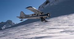 Classic Alaskan Bush Plane Flies Low Over Ridge Past Sunburst Tor with Audio. Stock Footage