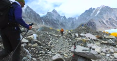 A tourist walks in the Everest base camp on the glacier Khumbu- Nepal Himalayas. Stock Footage