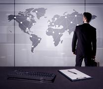 Business person drawing dots on world map Stock Photos
