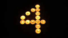 Tealight Candle Number Four Stock Footage