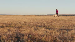 Girl running with a dog Stock Footage