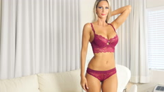 Sexy lingerie blonde girl in luxury suite dancing slow Stock Footage