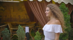 The young woman walk along the restaurant terrace. Slow motion. Wide angle Stock Footage