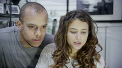 4K Attractive young couple sitting in front of a computer screen Stock Footage
