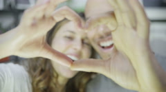 4K Happy young couple make a heart shape with their hands Stock Footage
