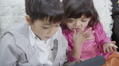 4K Cute young children are playing on a tablet computer Stock Footage