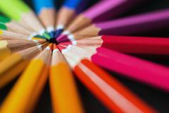 Color pencils in arrange in color wheel. Assortment of colored pencils. Stock Photos