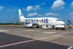 BALI AIRPORT, INDONESIA - AUGUST 28, 2008: Airplane of Batavia air company at Stock Photos