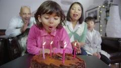 4K Family enjoying a Birthday celebration for young daughter Stock Footage