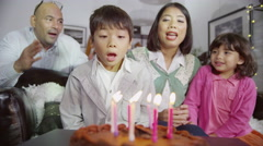 4K Happy family enjoying a Birthday celebration for young son Stock Footage