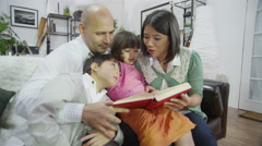 4K Family at home together with mother reading to her children Stock Footage