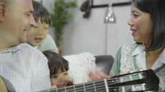 4K Happy family singing together with father playing the guitar Stock Footage