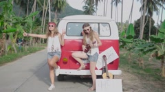 Hippie Girls Stop Cars on a Road Leaning on a Minivan. Slow Motion Stock Footage