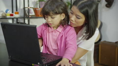4K Mother and daughter browsing the internet together Stock Footage