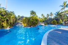 BALI, INDONESIA - AUGUST 29, 2008: Tourists swimming in enormous exotic pool Stock Photos