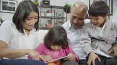 4K Mother and father bonding with their children at home Stock Footage