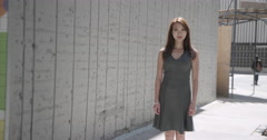 Beautiful Asian woman standing next to concrete wall in city 4K Stock Footage