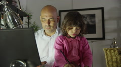 4K Busy father working at home and also taking care of his young daughter Stock Footage