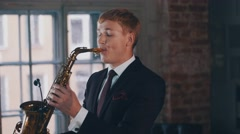 Saxophonist in dinner jacket play on golden saxophone. Live performance. Jazz Stock Footage